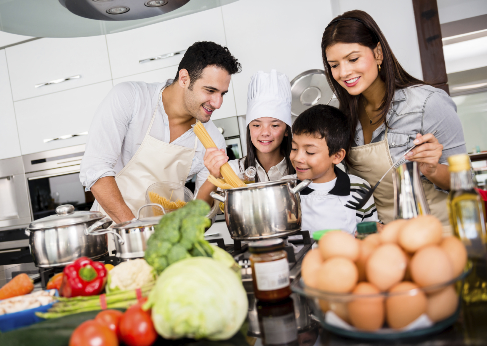 Family cooking kitchen - Beautiful Family Cooking Together Dinner And Looking Very Happy