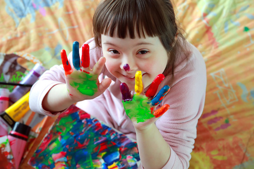 Cute little girl with painted hands
